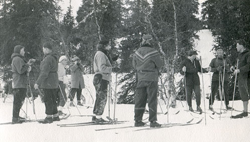 grandfather skiing with friends