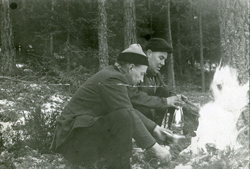 grandfather with friend in the forest. grandfather to the right